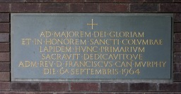 """Foundation stone: the Latin inscription reads """"To the greater glory of God and in honour of Saint Columba, this foundation stone was blessed and dedicated by the Reverend Canon Francis Murphy on 6th September 1964"""""""