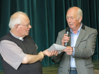 Paul Wrigglesworth presents the parishioners' gift to Fr Cooke