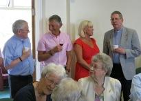 Fr John Joyce & Fr John McManus try the lemonade - Peter Fogg tries the wine!