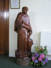 Carved wooden statue in rear porch