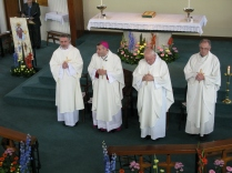 Bishop Mark Davies, with Deacon Lawrence Hordley, Parish Priest Fr Russell Cooke, and Parish Priest of St Theresa's Fr James Kenny
