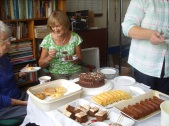 Ann Evans enjoying Hazel Myatt's coffee and cakes