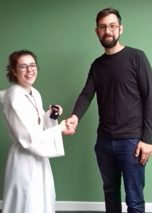 Bridget Lusk receives medal of St Bridget in recognition of 10+ years as Altar Server - with Trainer Richard Curtis